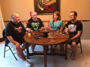 Four podcasters sitting at a table