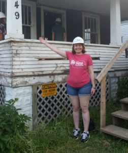 Amy Bowen standing in front of one of the houses in progress we visited on our HabiTour today.
